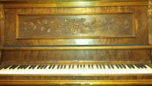 Olivia Newport antique piano